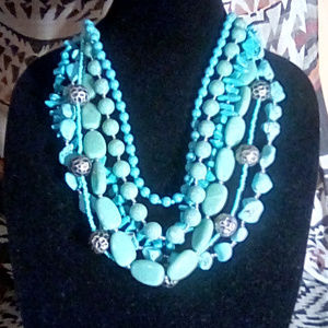 Six strand faux turquoise and acrylic bead necklac